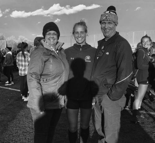 Carly with her parents Eric and Joy.