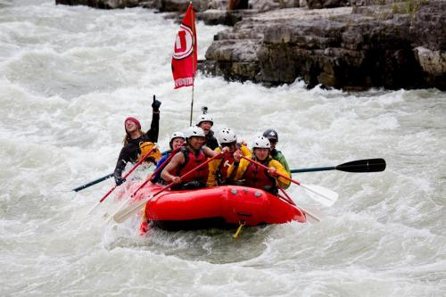 Rafting with University of Utah flag