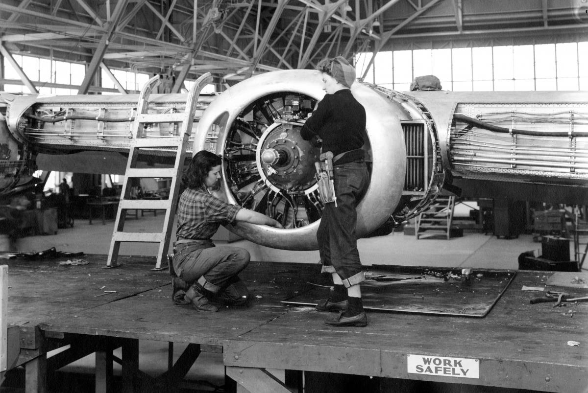 Women working on airplane